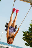 Playful crazy girl on swing. Royalty Free Stock Photo