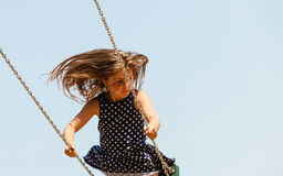 Playful crazy girl on swing. Royalty Free Stock Images