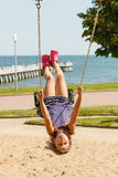 Playful crazy girl on swing. Stock Photography