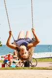Playful crazy girl on swing. Stock Image