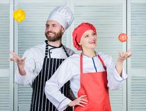 Playful culinary master. Family cooking in kitchen. happy couple in love with healthy food. Dieting and vitamin. Culinary cuisine. man and woman chef in stock photography