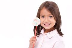 Playful cute little girl posing with pastel color marshmallow Royalty Free Stock Photos