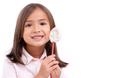 Playful cute little girl posing with sweet pastel color marshmal Stock Photo