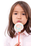 Playful cute little girl posing with sweet pastel color marshmal Stock Images