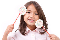 Playful cute little girl posing with sweet pastel color marshmal Royalty Free Stock Image