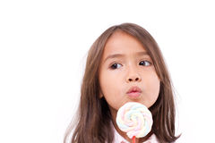 Playful cute little girl with sweet colorful marshmallow Royalty Free Stock Photography