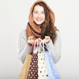 Playful cute winter girl with shopping bags Royalty Free Stock Images