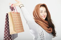 Playful cute winter girl with shopping bags Royalty Free Stock Image
