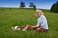Playful Dog and Woman in the Countryside Stock Photo