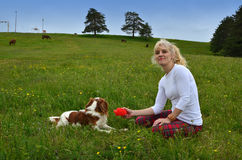 Playful Dog and Woman in the Countryside Royalty Free Stock Photography