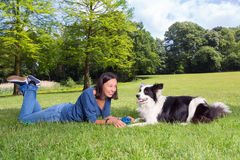 Playful dog and woman. Playful dog waiting for his boss to throw the ball stock photo