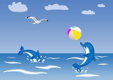 Playful dolphins. Two dolphins are playing ball in the sea Royalty Free Stock Image