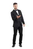 Playful excited young groom tossing wedding ring Stock Image