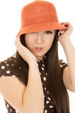 Playful expression on teens face wearing cute orange hat Stock Photo