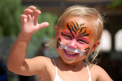 Playful face painted child Stock Photos