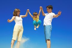 Playful family. Family playing with boy in summertime Royalty Free Stock Photography