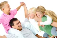 Playful family. Portrait of parents doing piggyback to their children Stock Images
