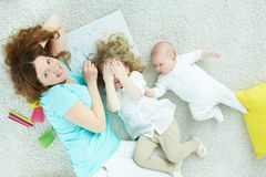 Playful family. Above-view image of a playful family enjoying spending time together Stock Images