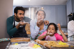 Playful family blowing flour in kitchen. At home Stock Photo