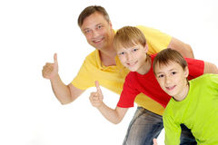 Playful family in bright T-shirts Royalty Free Stock Images