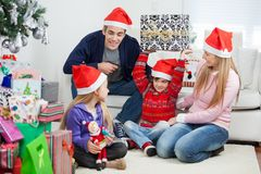 Playful Family With Christmas Gifts. At home Stock Image