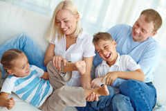 Playful family. Family fooling at home and laughing Royalty Free Stock Photos