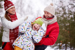 Playful family. Happy parents playing with carefree daughter in park Royalty Free Stock Photos