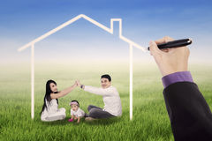 Playful family under a dream house Royalty Free Stock Photos