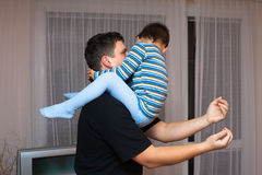 Playful father and child boy Stock Images
