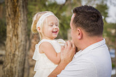 Playful Father With Cute Baby Girl Outside at the Park Stock Photo