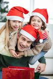 Playful Father Piggybacking Children During Stock Photography