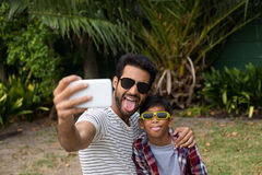 Playful father and son taking selfie Royalty Free Stock Image