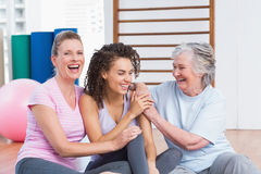 Playful female friends sitting in gym Royalty Free Stock Photography