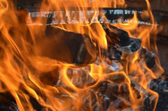Playful flames in a fire. Playful great wood flames in the evening and hor air in there Royalty Free Stock Photo