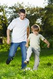 Playful football in park Royalty Free Stock Photography