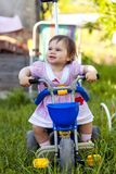 A playful funny girl  on her bike Royalty Free Stock Photos