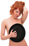 Playful ginger-haired woman and black hat Royalty Free Stock Photography