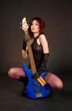 Playful girl with bass guitar Royalty Free Stock Photos