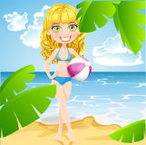 Girl with inflatable ball on sunny beach Stock Photos