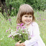 Playful Girl with Bunch of Wild Flowers Stock Image