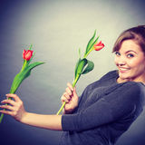 Playful girl having fun with flowers tulips. Stock Photography
