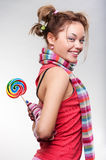Playful girl with lollipop Royalty Free Stock Images