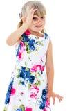 Playful girl looking through her fingers. Stock Photos