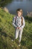 Playful girl near river royalty free stock photos