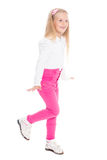 Playful girl in pink jeans. Royalty Free Stock Images