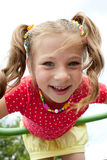 Playful girl plays on the playground Royalty Free Stock Images