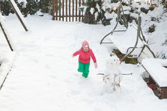 Playful girl running, playing in home backyard stock images