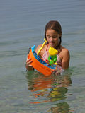 Playful girl in the sea 1 Stock Photos