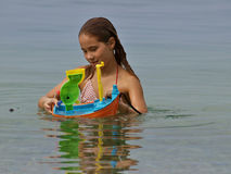 Playful girl in the sea royalty free stock photo