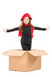 Playful girl standing in a box Royalty Free Stock Image